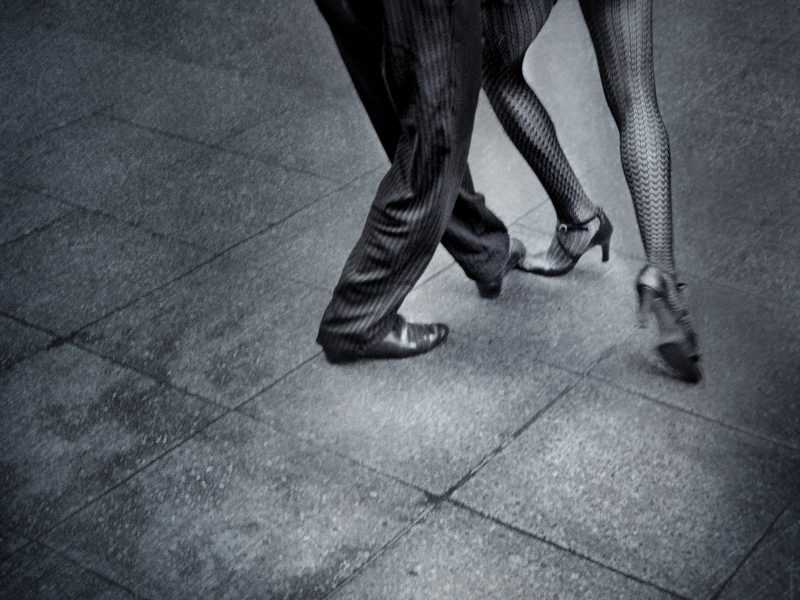 Tango dancers in the street. Analogical B&W shot with romantic atmospher.